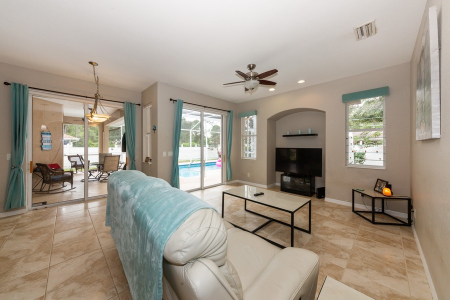 Real Estate Photography - 3475 Lotus Rd, North Port, FL, 34291 - Family Room