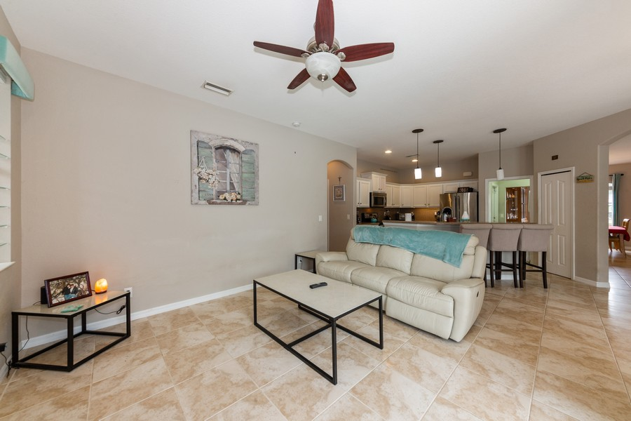 Real Estate Photography - 3475 Lotus Rd, North Port, FL, 34291 - Family Room / Kitchen