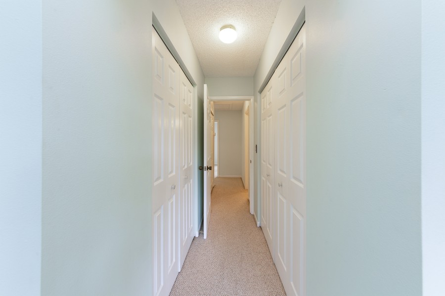 Real Estate Photography - 1410 57th Street West, Bradenton, FL, 34209 - Master Bedroom Closet