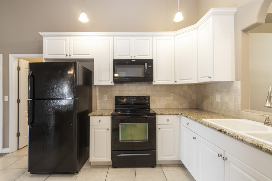 Real Estate Photography - 140 Red Maple Burl Cir, Debary, FL, 32713 - Kitchen