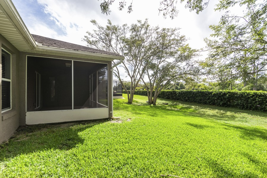 Real Estate Photography - 140 Red Maple Burl Cir, Debary, FL, 32713 - Back Yard