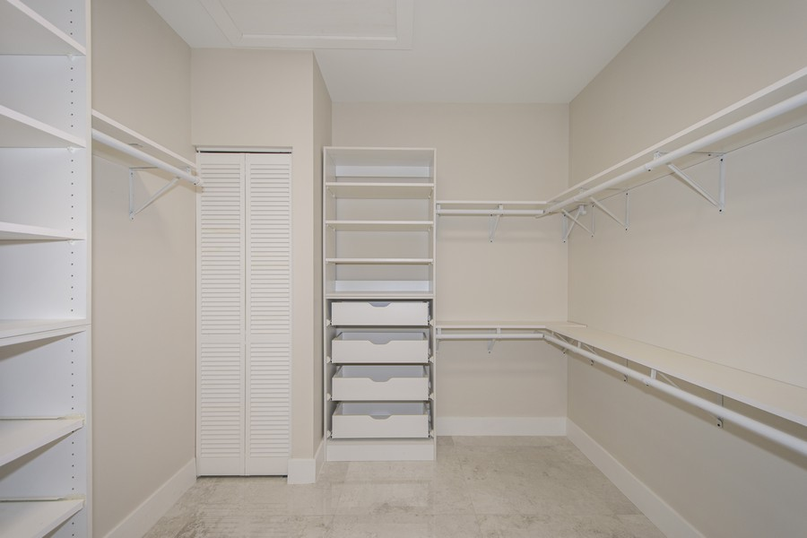 Real Estate Photography - 12100 NW 27th Street, Plantation, FL, 33323 - Master Bedroom Closet
