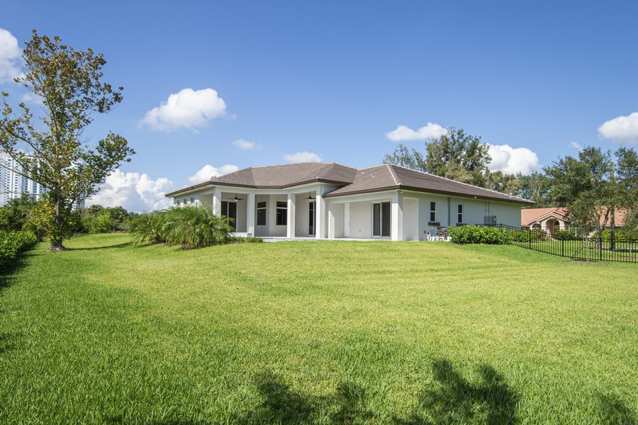 Real Estate Photography - 12100 NW 27th Street, Plantation, FL, 33323 - Rear View