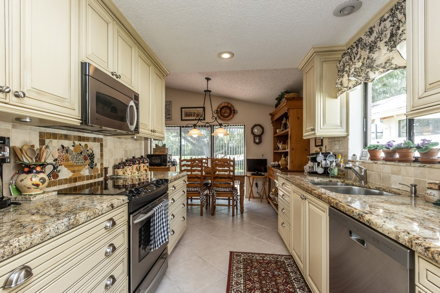 Real Estate Photography - 11150 Clover Leaf Cir, Boca Raton, FL, 33428 - Kitchen