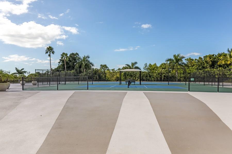 Real Estate Photography - 5601 Turtle Bay Dr, Unit 2004, Naples, FL, 34108 - Tennis Court