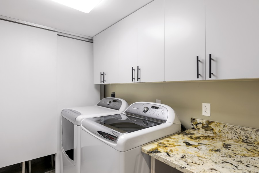 Real Estate Photography - 5601 Turtle Bay Dr, Unit 2004, Naples, FL, 34108 - Laundry Room