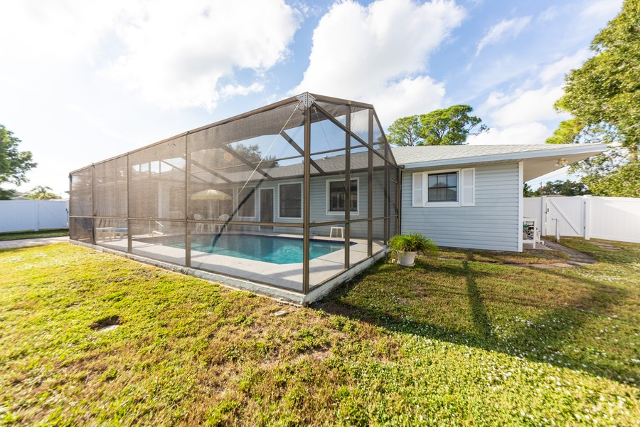Real Estate Photography - 415 Bluebell Rd, Venice, FL, 34293 - Rear View