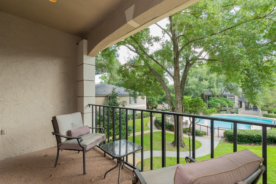 Real Estate Photography - 1055 Kensington Park Dr, Unit 803, Altamonte Springs, FL, 32714 - Clubhouse balcony overlooking Pool #1