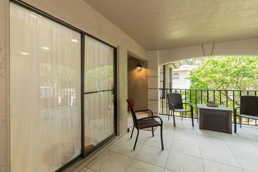 Real Estate Photography - 1055 Kensington Park Dr, Unit 803, Altamonte Springs, FL, 32714 - Front porch with sliders to kitchen