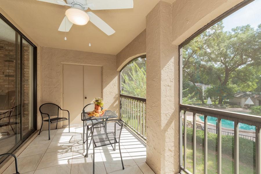 Real Estate Photography - 1055 Kensington Park Dr, Unit 803, Altamonte Springs, FL, 32714 - Balcony overlooking Pool #2