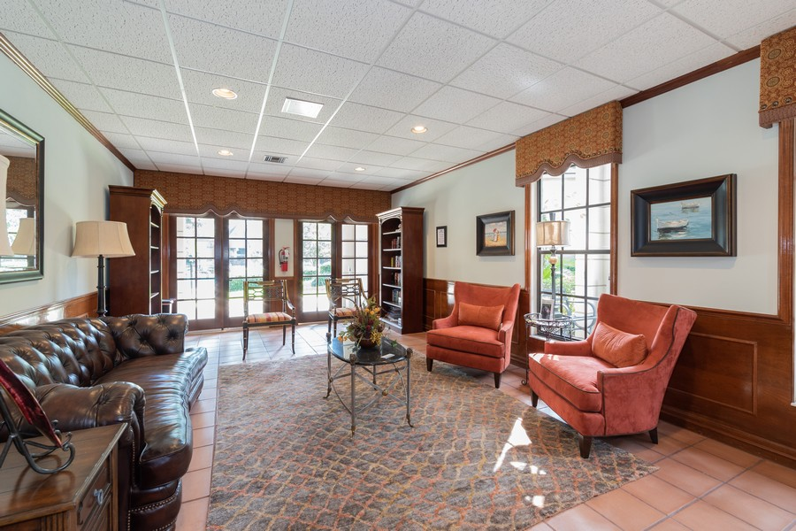 Real Estate Photography - 1055 Kensington Park Dr, Unit 803, Altamonte Springs, FL, 32714 - Library in clubhouse
