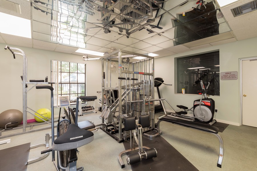 Real Estate Photography - 1055 Kensington Park Dr, Unit 803, Altamonte Springs, FL, 32714 - Fitness Center in clubhouse
