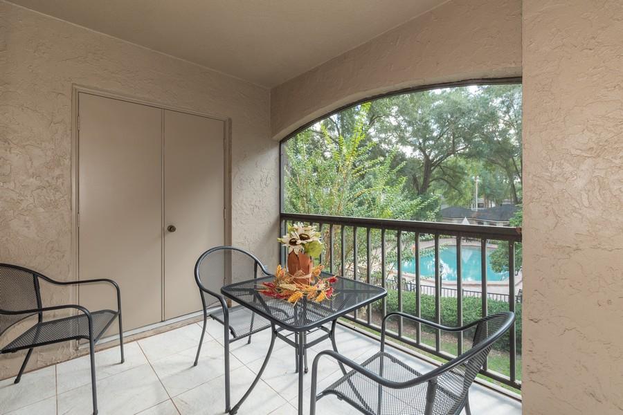Real Estate Photography - 1055 Kensington Park Dr, Unit 803, Altamonte Springs, FL, 32714 - Balcony with storage closet