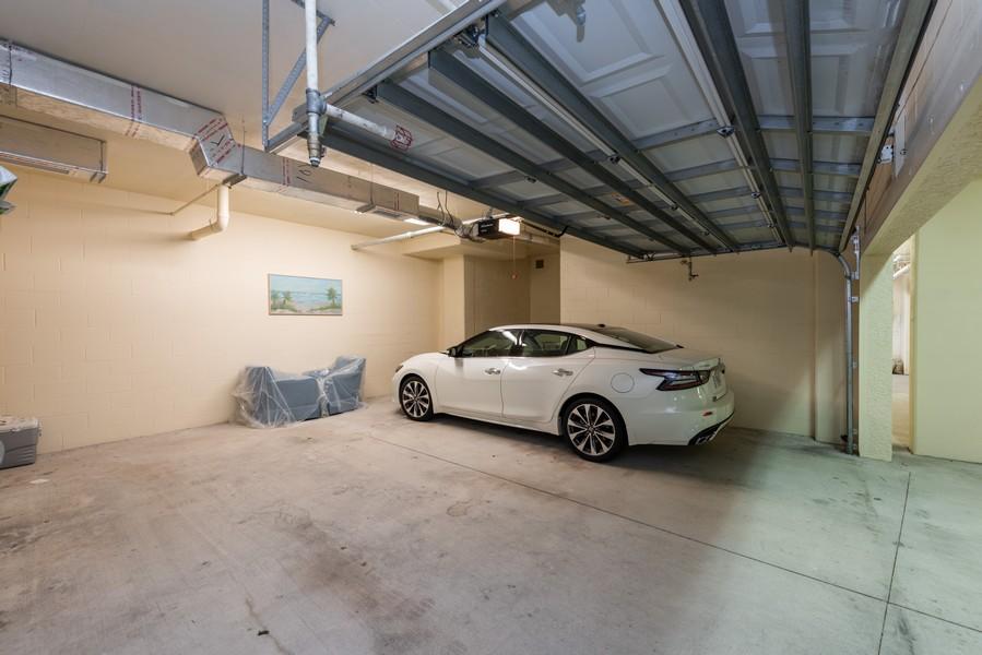 Real Estate Photography - 85 Avenue de la mer, 1106, Palm Coast, FL, 32137 - Private 2 Car Oversized garage