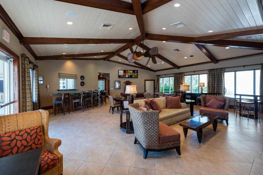 Real Estate Photography - 85 Avenue de la mer, 1106, Palm Coast, FL, 32137 - Tuscany Poolside Social Room