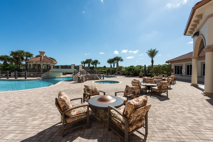 Real Estate Photography - 85 Avenue de la mer, 1106, Palm Coast, FL, 32137 - Tuscany Pool, Hot Tub and Fire Pit