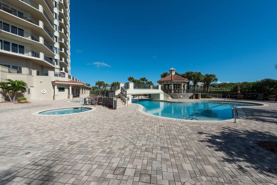 Real Estate Photography - 85 Avenue de la mer, 1106, Palm Coast, FL, 32137 - Tuscany Pool and Grill Area
