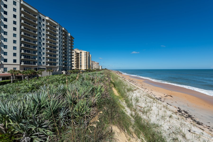 Real Estate Photography - 85 Avenue de la mer, 1106, Palm Coast, FL, 32137 - Beach heading North
