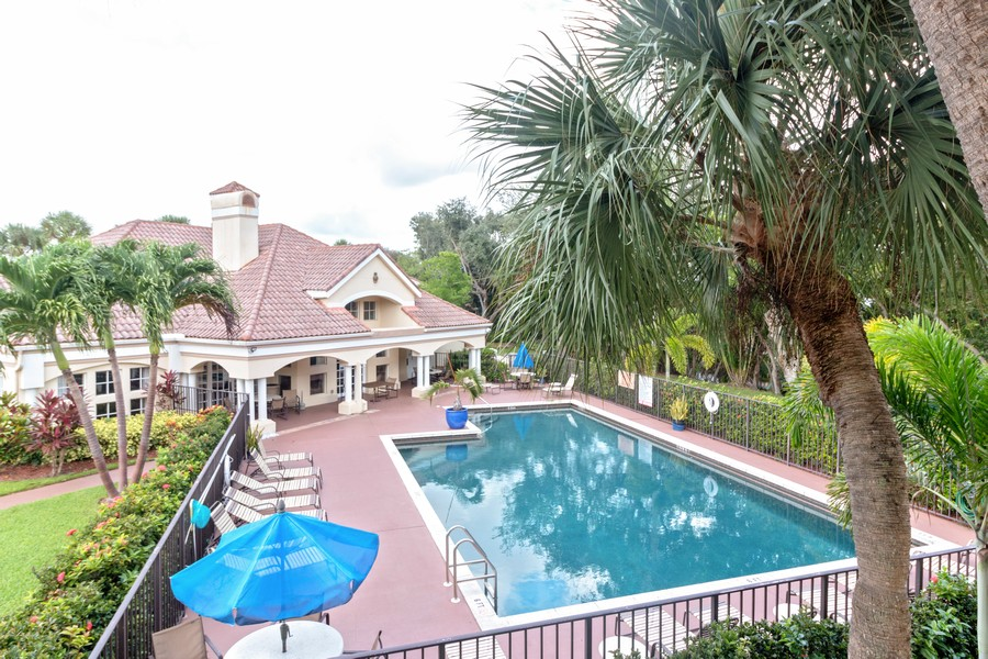 Real Estate Photography - 815 W Boynton Beach Boulevard, 13-201, Boynton Beach, FL, 33426 - View of the Pool and Clubhouse