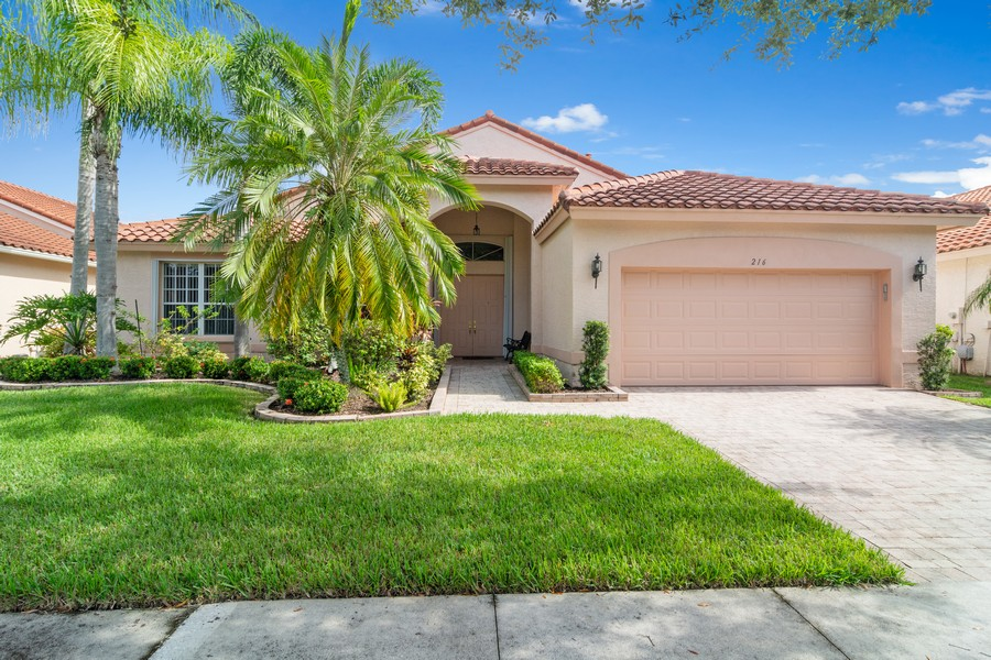Real Estate Photography - 216 NW Liseron Way, Port St Lucie, FL, 34986 - Front View