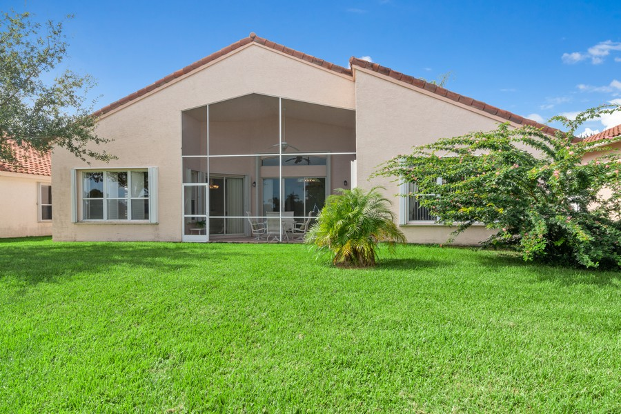 Real Estate Photography - 216 NW Liseron Way, Port St Lucie, FL, 34986 - Rear View