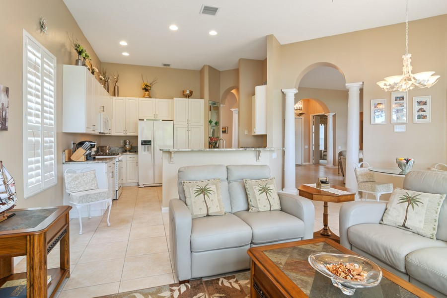 Real Estate Photography - 216 NW Liseron Way, Port St Lucie, FL, 34986 - Family Room / Kitchen