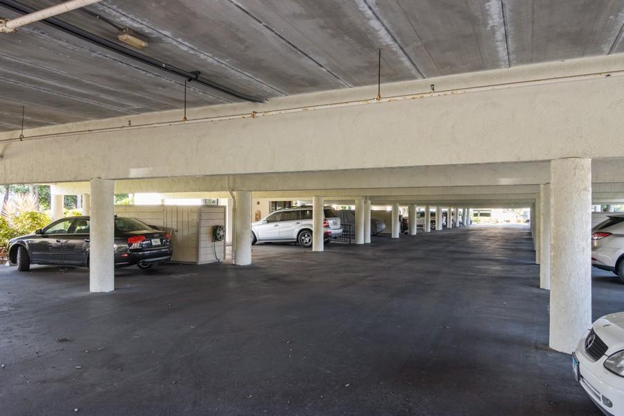 Real Estate Photography - 3905 Mariner's Walk, 815, Cortez, FL, 34215 - Parking Garage