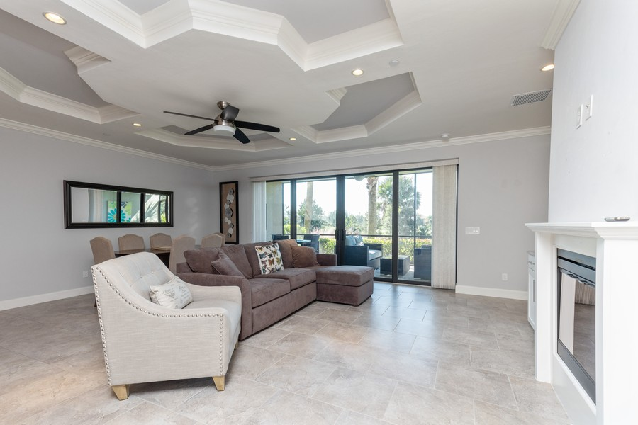 Real Estate Photography - 8756 Bellano Ct, Unit 103, Naples, FL, 34119 - Living Room