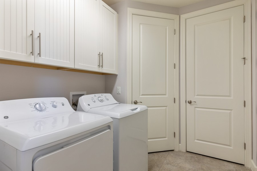 Real Estate Photography - 8756 Bellano Ct, Unit 103, Naples, FL, 34119 - Laundry Room
