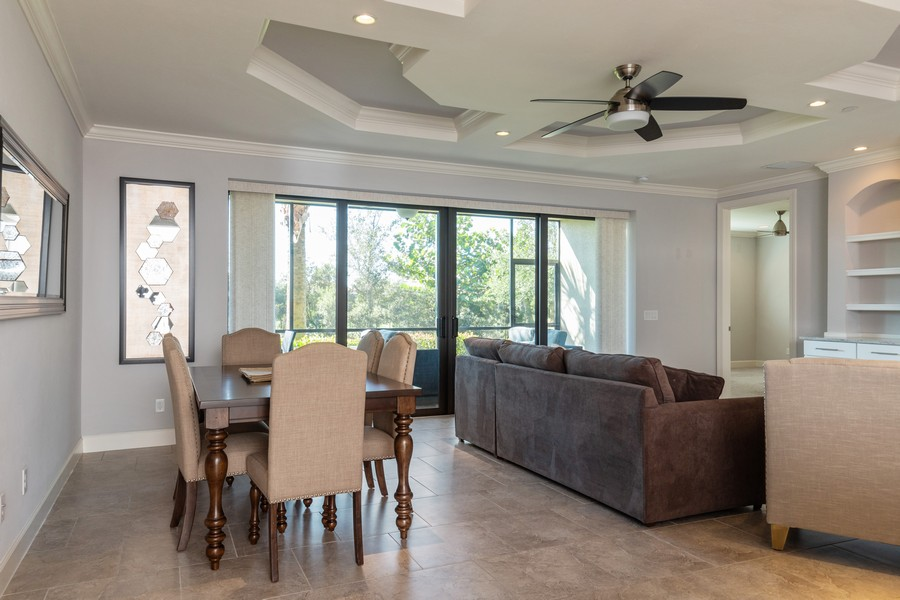 Real Estate Photography - 8756 Bellano Ct, Unit 103, Naples, FL, 34119 - Living Room/Dining Room