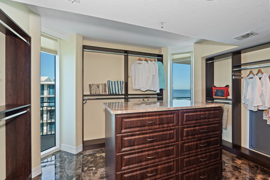 Real Estate Photography - 1323 Highway A1A, 601, Satellite Beach, FL, 32937 - Master Bedroom Closet