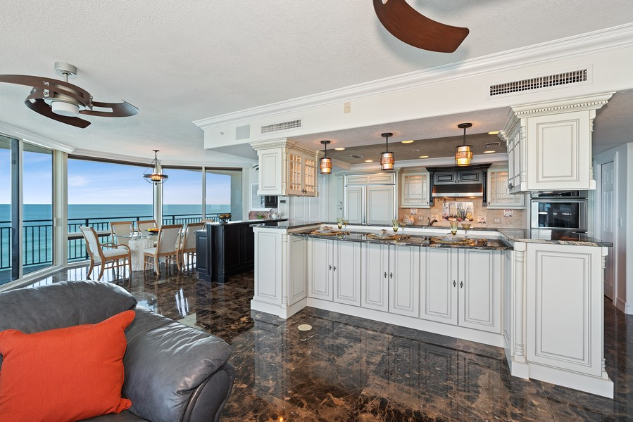 Real Estate Photography - 1323 Highway A1A, 601, Satellite Beach, FL, 32937 - Kitchen / Dining Room