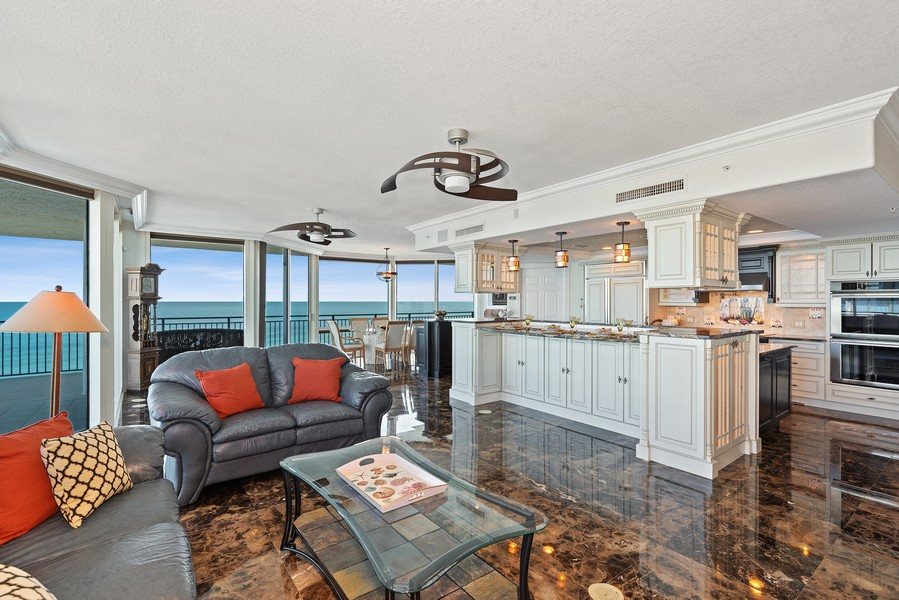 Real Estate Photography - 1323 Highway A1A, 601, Satellite Beach, FL, 32937 - Family Room / Kitchen