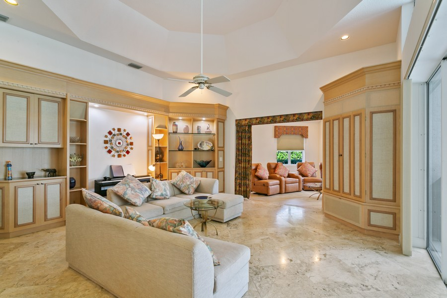 Real Estate Photography - 103 Woodsmuir Ct, Palm Beach Gardens, FL, 33418 - Family Room with Entry to Media Room
