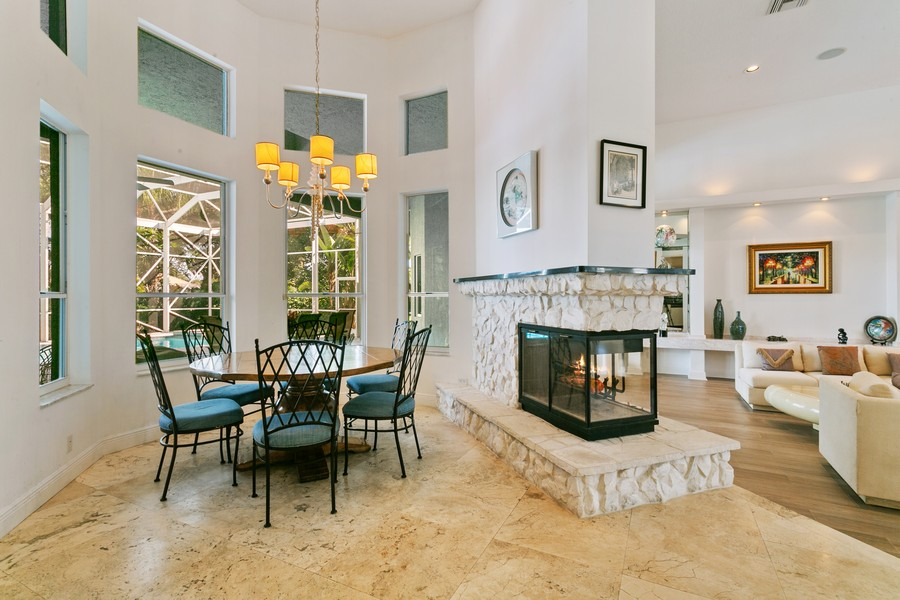 Real Estate Photography - 103 Woodsmuir Ct, Palm Beach Gardens, FL, 33418 - Eat in Kitchen/ Dual Fireplace/ Formal Living Room
