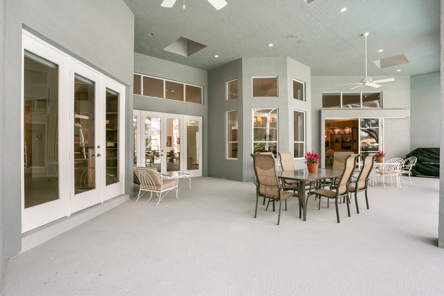 Real Estate Photography - 103 Woodsmuir Ct, Palm Beach Gardens, FL, 33418 - Large Screened Lanai
