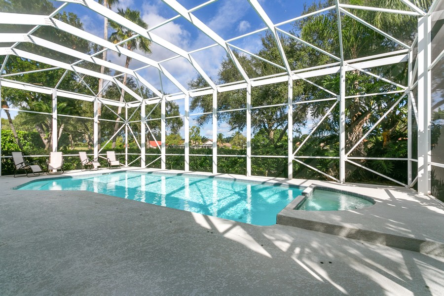Real Estate Photography - 103 Woodsmuir Ct, Palm Beach Gardens, FL, 33418 - Screened Pool and Jacuzzi