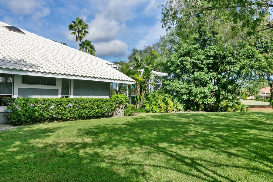 Real Estate Photography - 103 Woodsmuir Ct, Palm Beach Gardens, FL, 33418 - Side Yard of the home