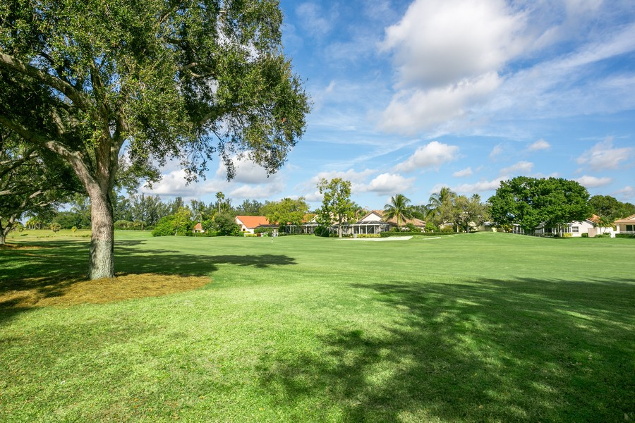 Real Estate Photography - 103 Woodsmuir Ct, Palm Beach Gardens, FL, 33418 - View of the 6th hole of the Palmer Golf Course