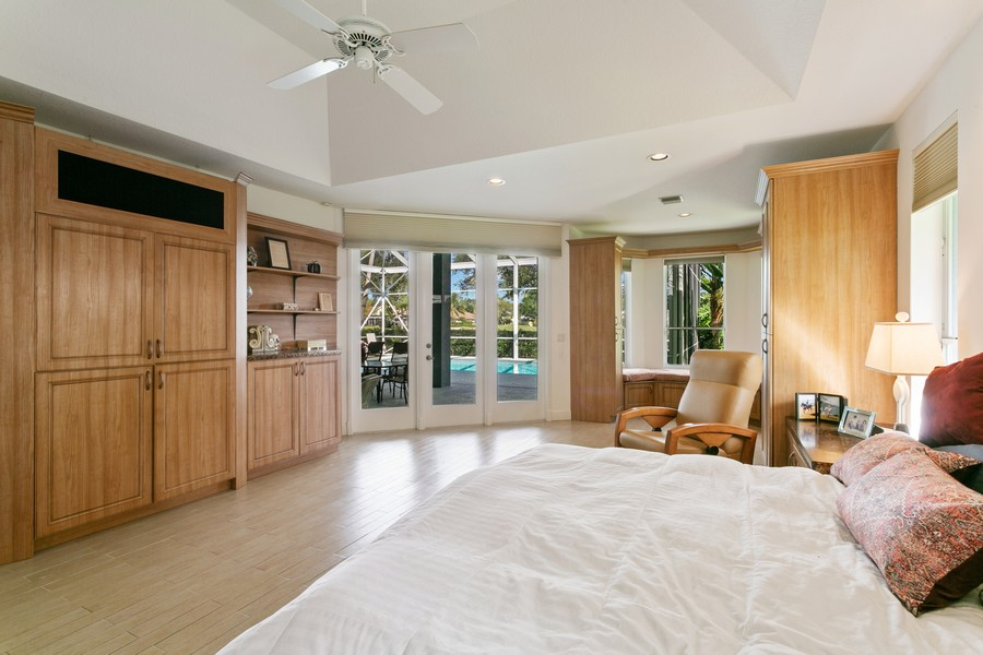 Real Estate Photography - 103 Woodsmuir Ct, Palm Beach Gardens, FL, 33418 - Master Suite with Built In's