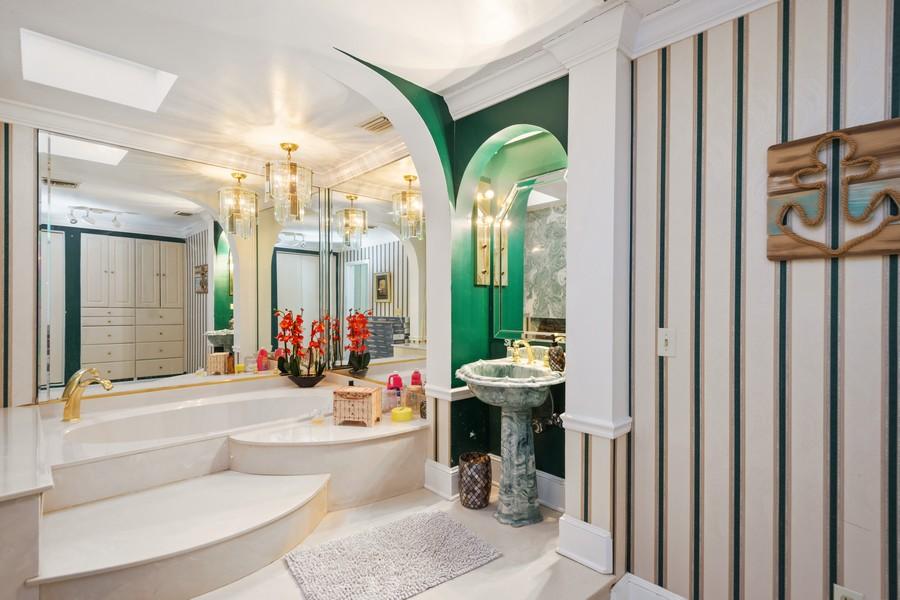 Real Estate Photography - 1925 Dolphin Dr, Belleair Bluffs, FL, 33770 - Master Bathroom