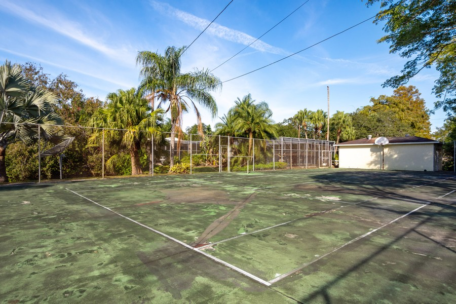 Real Estate Photography - 1925 Dolphin Dr, Belleair Bluffs, FL, 33770 - Tennis Court