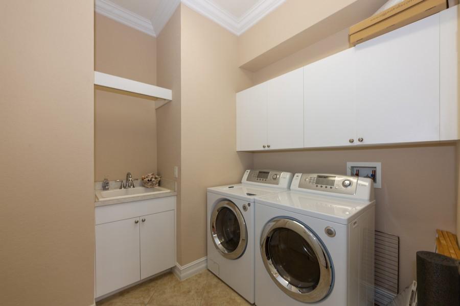 Real Estate Photography - 16177 Parque Lane, Naples, FL, 34110 - Laundry Room