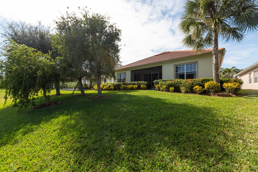 Real Estate Photography - 16177 Parque Lane, Naples, FL, 34110 - Rear View