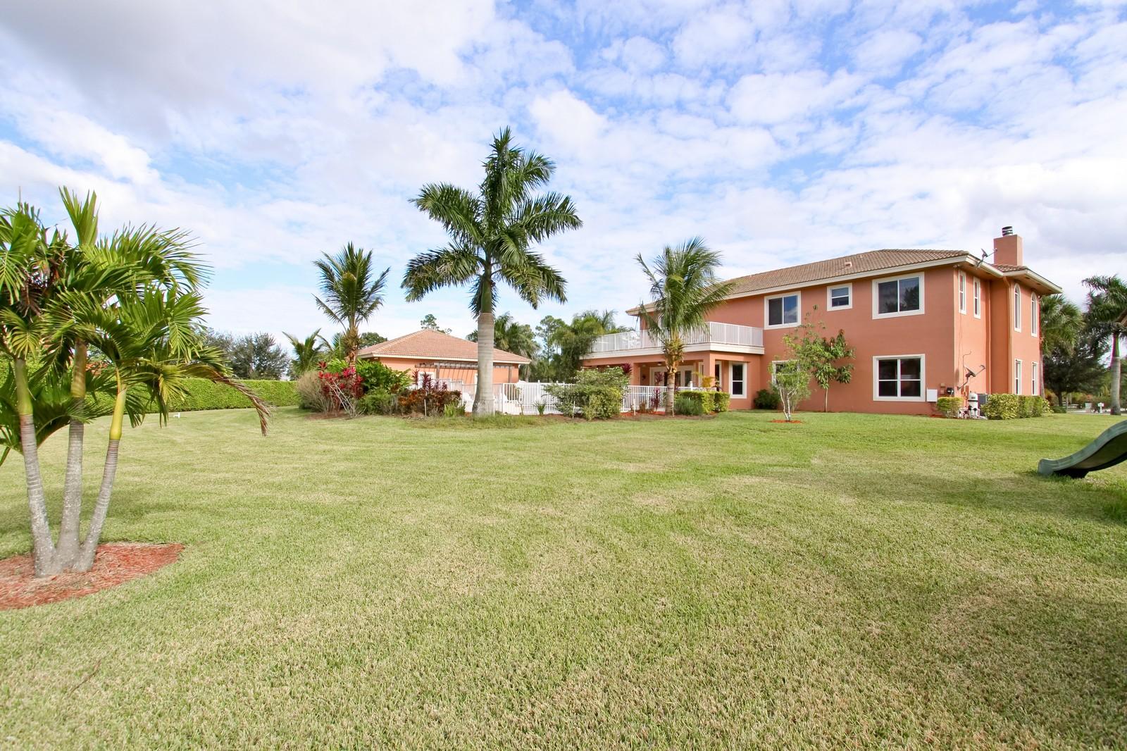 Real Estate Photography - 14542 Draft Horse Ln, Wellington, FL, 33414 - Rear View