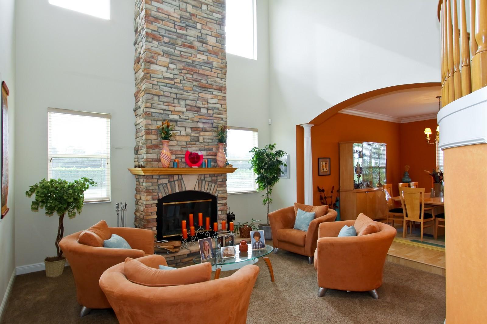 Real Estate Photography - 14542 Draft Horse Ln, Wellington, FL, 33414 - Living Room / Dining Room