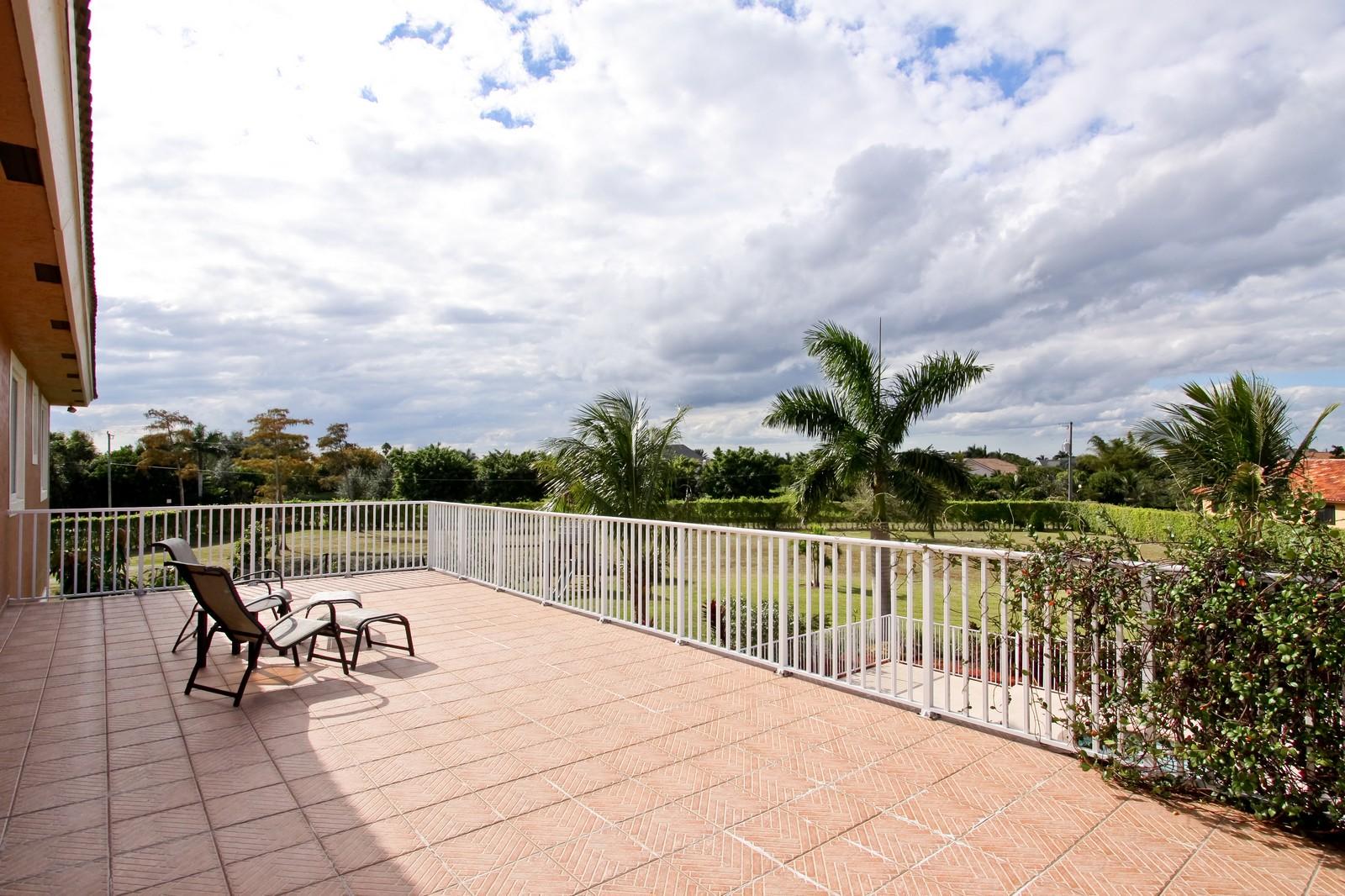 Real Estate Photography - 14542 Draft Horse Ln, Wellington, FL, 33414 - Balcony
