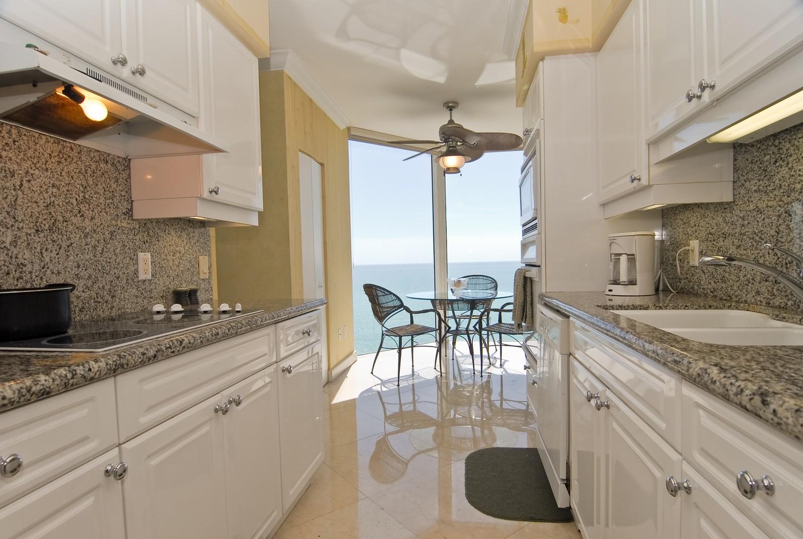 Real Estate Photography - 4779 Collins Ave, Unit 1901, Miami Beach, FL, 33140 - Kitchen / Breakfast Room