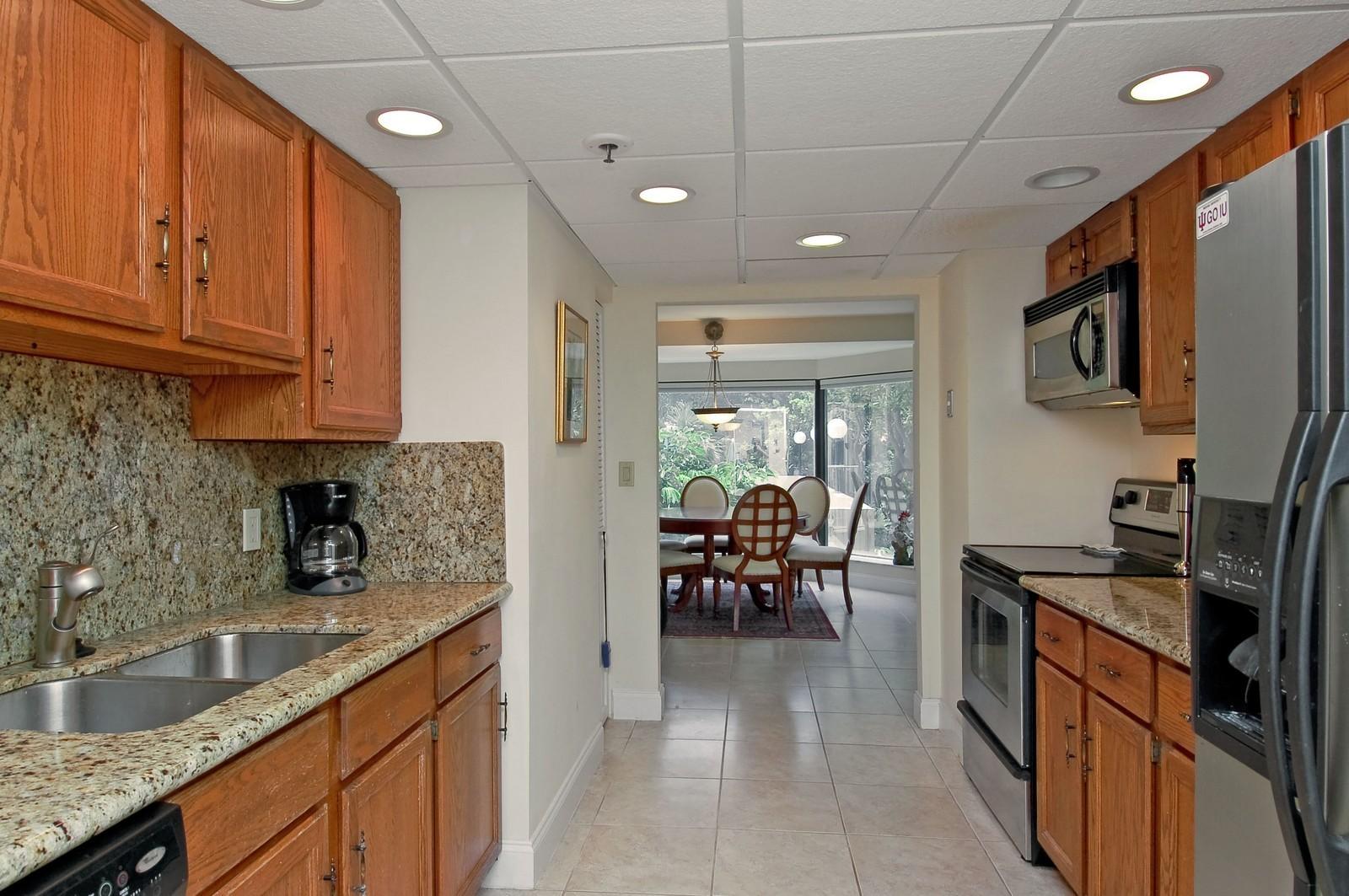 Real Estate Photography - 4605 S Ocean Blvd, Unit 3B, Highland Beach, FL, 33487 - Kitchen