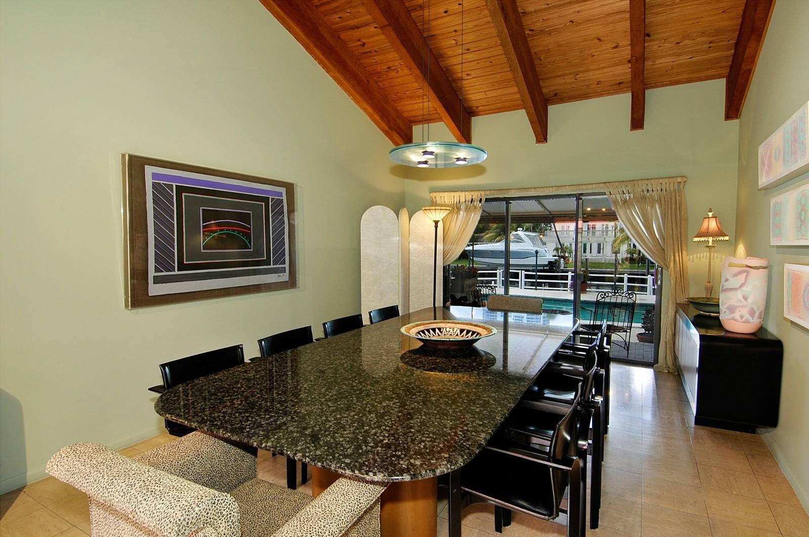 Real Estate Photography - 622 Golden Beach Dr, Golden Beach, FL, 33160 - Dining Room